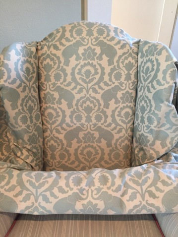 I bought 8 yards of fabric, it's called Babar Elephants Serenity by Covington. It's a nice heavy and soft feeling jacquard. It just couldn't be more perfect for me. I placed it on the chair and I must say that I love it and if I do this right, the chair will be beautiful.